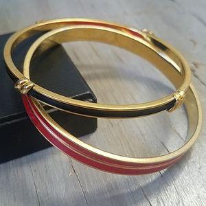 Pair of Monet gold toned enamel bangles